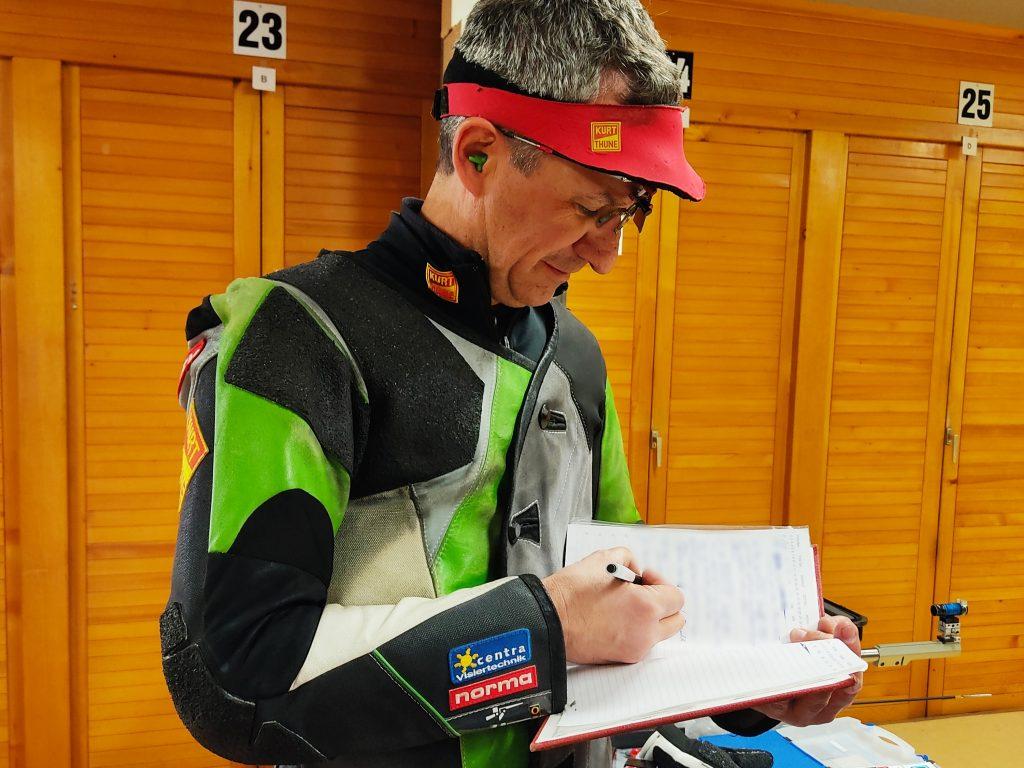 Rajmond Debevec writing shooting analysis into his performance log